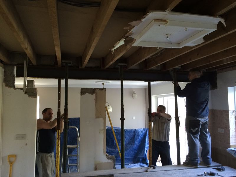 instilling a structural support beam in an open plan kitchen