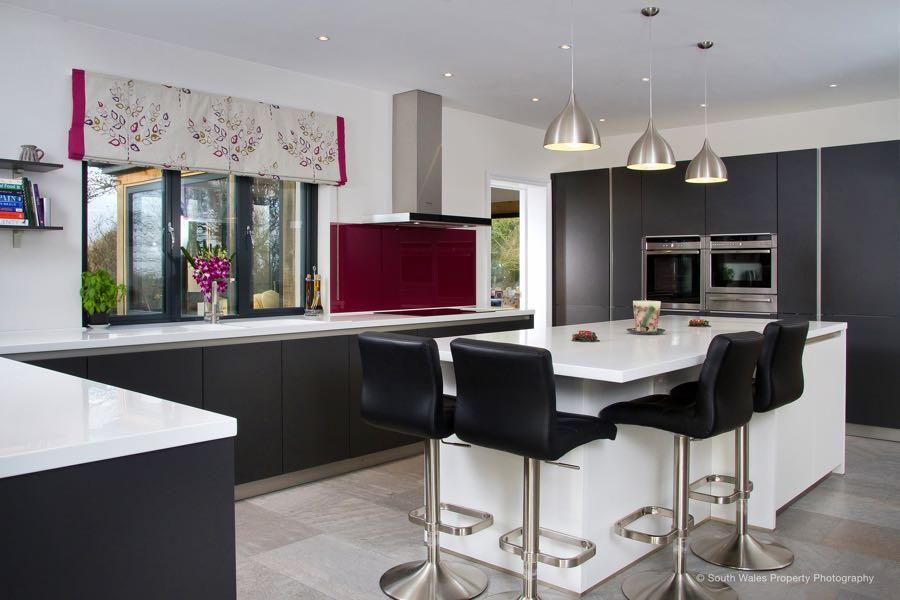 Schuller kitchen in Lava Black with white Corian worktops
