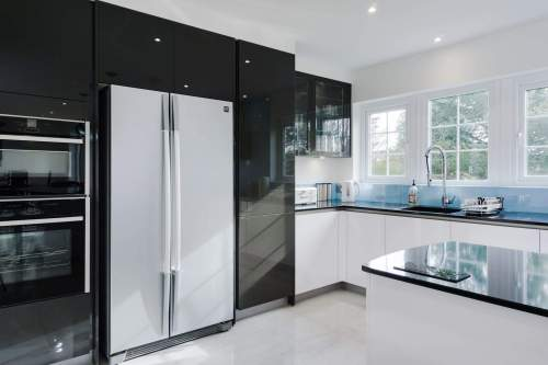 Gloss lacquered stratus grey tall units