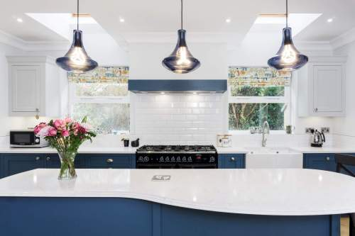 modern lighting in a traditional kitchen